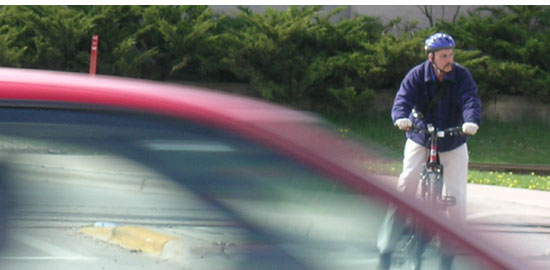 Subject: Bicyclist waiting for traffic; Location: John Nolen Drive, Madison, WI; Date: 2005; Photographer: Carrie Scherpelz